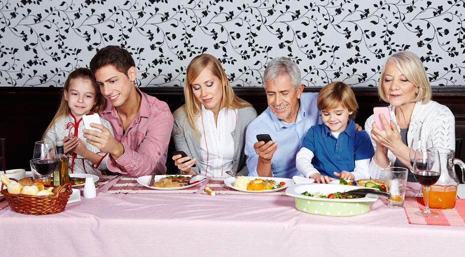 Family looking at their smartphones