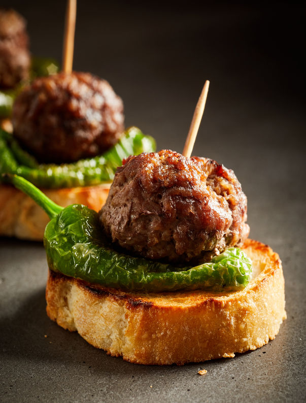 Roasted meatballs with pepper on baked bread