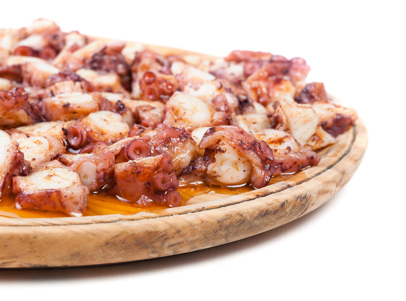 Pulpo a feira in a wooden plate