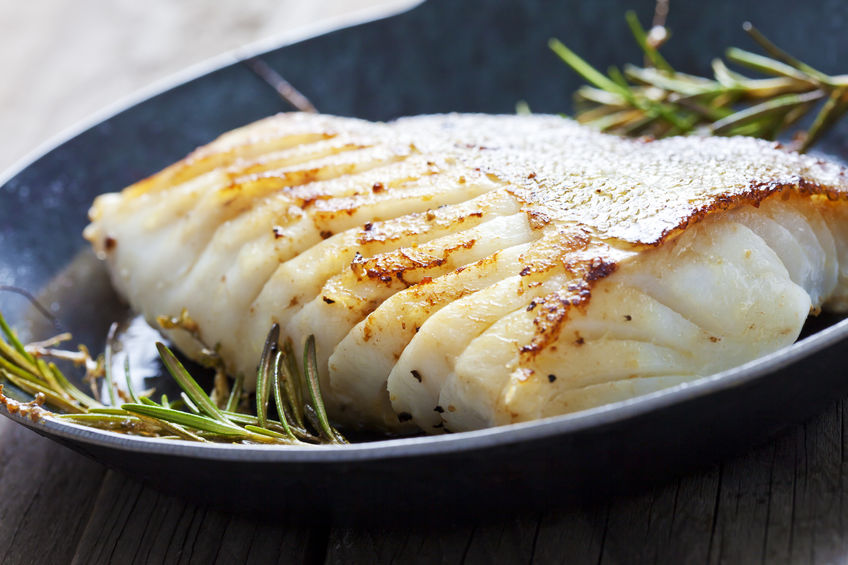 38582351 - fried fish fillet, atlantic cod with rosemary in pan